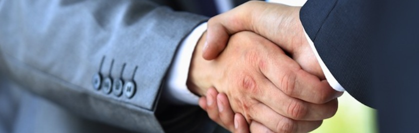 Photo of People Shaking Hands